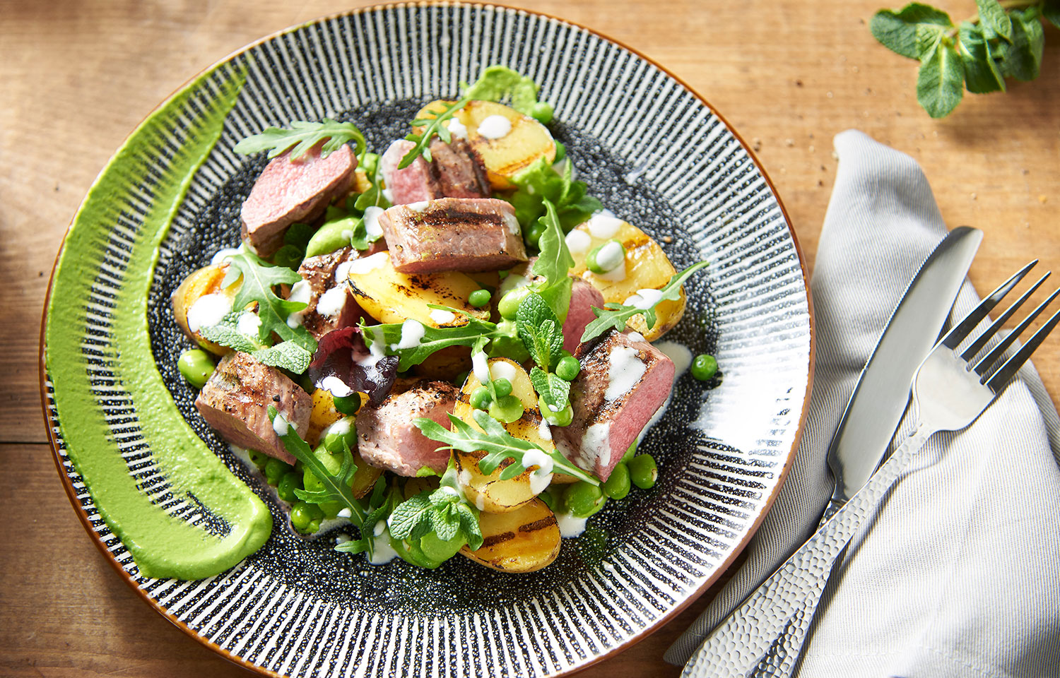 Grilled lamb and potato salad with peas and mint